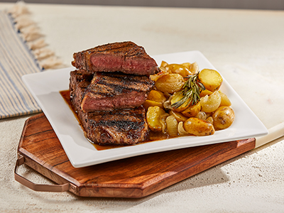 NY Strips with Potatoes